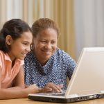 Child and parent using laptop